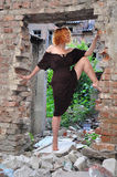 Grunge portrait of a  woman in urban ruins Royalty Free Stock Photos