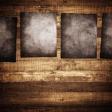 Grunge poster on wood background Royalty Free Stock Photos
