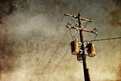 Grunge Power Lines. Old rusty power lines with a grunge background stock photo