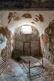 Grunge prison cell with sunlight window Royalty Free Stock Photo