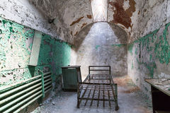 Grunge prison cell with sunlight window Stock Photography