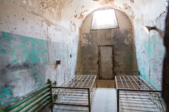 Grunge prison cell with sunlight window Royalty Free Stock Images