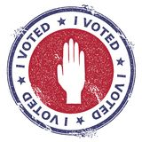 Grunge raised hand rubber stamp. USA presidential election patriotic seal with raised hand silhouette and I voted text. Rubber stamp vector illustration Royalty Free Stock Images