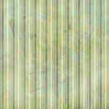 Grunge rayó el fondo en verdes Foto de archivo libre de regalías