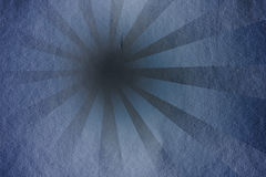 Grunge Rays - Blue. A grunge rays background with a blue tone and a dark copyspace point Stock Photo
