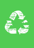 Grunge recycle sign. Grunge white recycle sign on green background Royalty Free Stock Photos