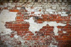 Grunge red brick wall texture. With remaining plaster (stucco Stock Photography