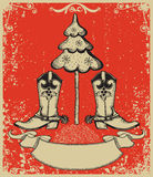 Grunge red christmas card with cowboy boots Stock Photo