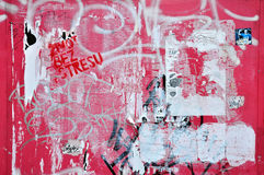 Grunge red city wall. Stripped posters and grafitti on red wall, Bratislava, Slovakia Royalty Free Stock Photography