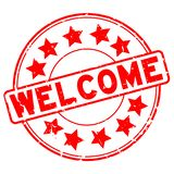 Grunge red welcome word with star icon round rubber stamp on white background stock photo