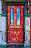 Grunge Red Wooden Door Stock Photography