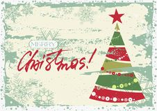 Merry Christmas greeting card. Grunge retro style greeting card for Merry Christmas and Happy New Year with stylized Christmas tree and hand written lettering in Royalty Free Stock Images