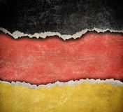Grunge ripped paper German flag Stock Images