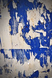 Grunge Ripped Poster Wall. Blue wall with layers of ripped posters Stock Photos