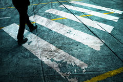 Grunge road crossing with feet Royalty Free Stock Photo