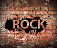 Grunge rock music poster. On red brick wall Stock Image