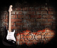Grunge rock music poster. On red brick wall Stock Images