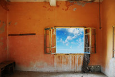 Grunge room with a beautiful blue sky outdoors Royalty Free Stock Images