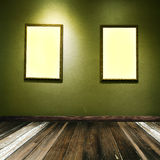 Grunge room green with Pictureframes Royalty Free Stock Images