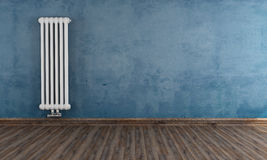 Grunge room with vertical radiator Stock Photography