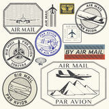 Grunge rubber ink stamps set with plane text air mail. Grunge rubber ink stamps set with plane and the text air mail, par avion written inside the stamp, vector Royalty Free Stock Photos