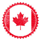 Grunge rubber stamp with Canada flag. Vintage travel stamp Stock Photography