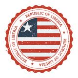 Grunge rubber stamp with Liberia flag. Vintage travel stamp with circular text, stars and national flag inside it. Vector illustration Stock Photos