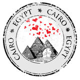 Grunge rubber stamp with Pyramid and the word Cairo, Egypt inside, vector royalty free illustration