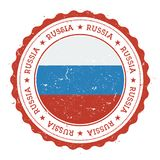 Grunge rubber stamp with Russian Federation flag. Royalty Free Stock Images