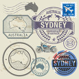 Grunge rubber stamp set with text and map of Australia Stock Images