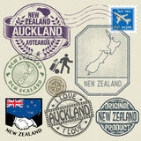 Grunge rubber stamp set with text and map of New Zealand Royalty Free Stock Photos