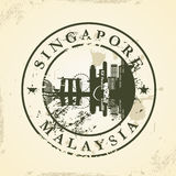 Grunge rubber stamp with Singapore, Malaysia Royalty Free Stock Photo