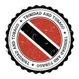 Grunge rubber stamp with Trinidad and Tobago flag. Royalty Free Stock Image