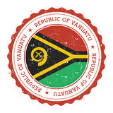 Grunge rubber stamp with Vanuatu flag. Royalty Free Stock Photography