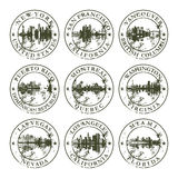 Grunge rubber stamps with american cities Stock Photos