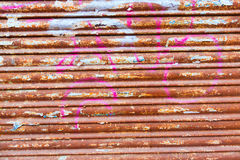 Grunge rusty iron door texture with stripes Royalty Free Stock Photo
