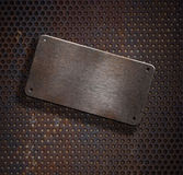 Grunge rusty metal plate over grid background Stock Images