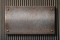 Grunge rusty metal plate over grid background stock photo