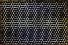 Grunge rusty perforated background Stock Photography
