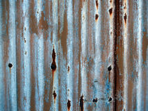 Grunge rusty plate of metal. Dark brown and blue grunge rusty plate of metal Stock Image