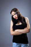 Grunge sad girl in tank top with cross on breast Royalty Free Stock Photos