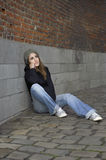 Grunge sad young woman with knitted hat Royalty Free Stock Photos