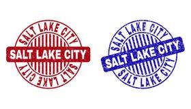 Grunge SALT LAKE CITY texturerade runda vattenstämplar royaltyfri illustrationer