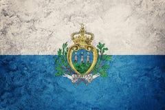 Grunge San Marino flag. San Marino flag with grunge texture. Royalty Free Stock Images