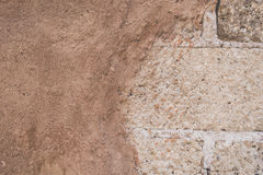 Grunge sandstone texture. Grunge beige sandstone texture together with white big bricks Royalty Free Stock Photography