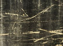 Grunge Scratched Black Concrete. An old black concrete wall with scratches and drip marks and streaks from years of wear and tear Royalty Free Stock Images