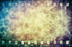 Grunge scratched colorful film strip with stars. Grunge scratched colorful film strip background with stars Royalty Free Stock Images