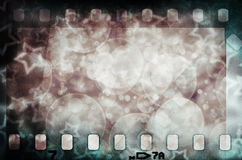 Grunge scratched colorful film strip with stars Royalty Free Stock Images