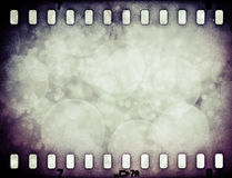 Grunge scratched colorful film strip with stars Stock Photo