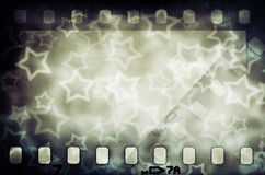 Grunge scratched colorful film strip with stars. Grunge scratched colorful film strip background with stars Stock Image